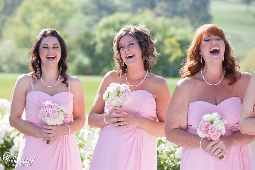 Pink bridesmaids laughing