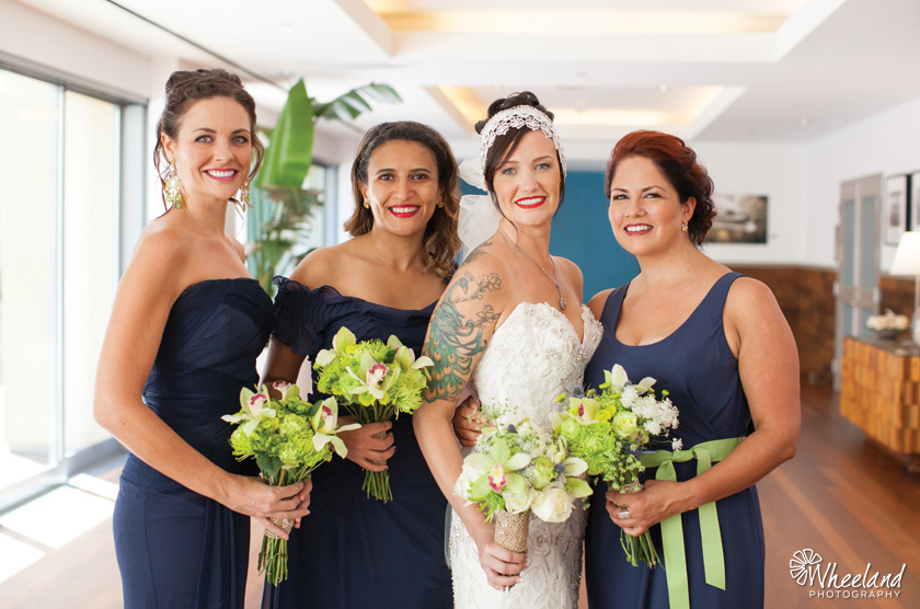 Bride and bridesmaids navy and green