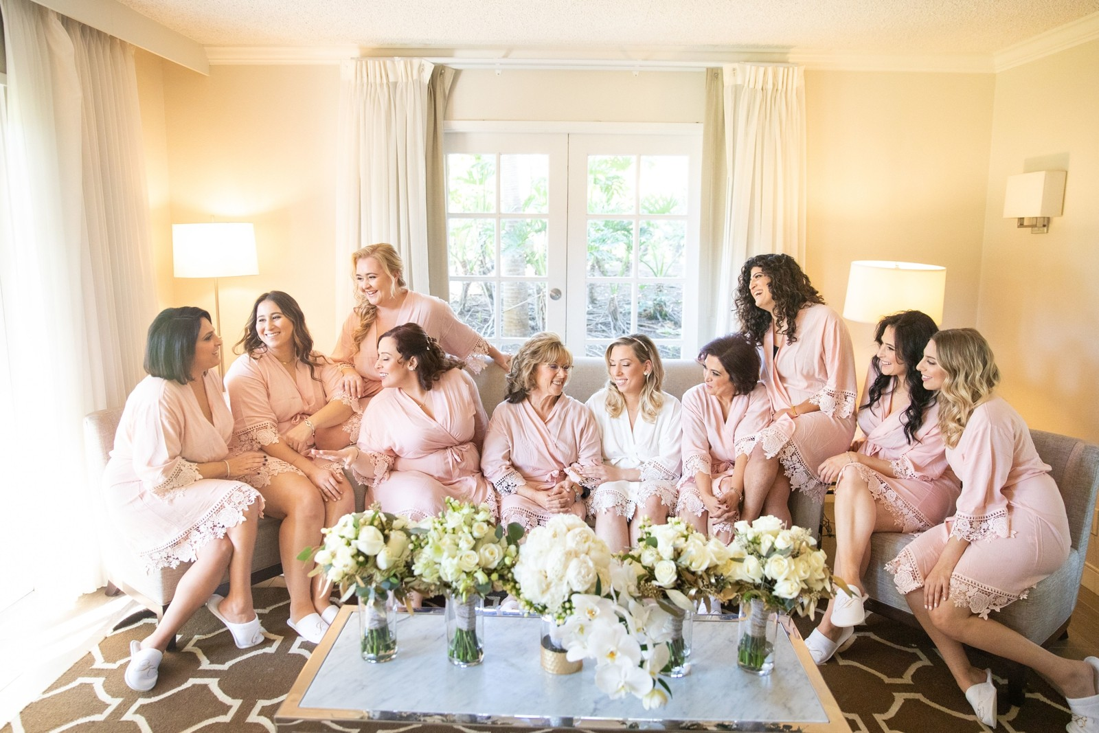 bride and girls in pink robes makeup and hair by flawless faces